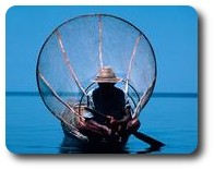 Fisherman with his net on Inle Lake, Myanmar