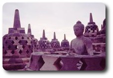 Buddha statue in stupa at Borobudur, Java, Indonesia