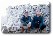 Jon and Kevin crouching on the icy summit of Scafell Pike, Lake District, England