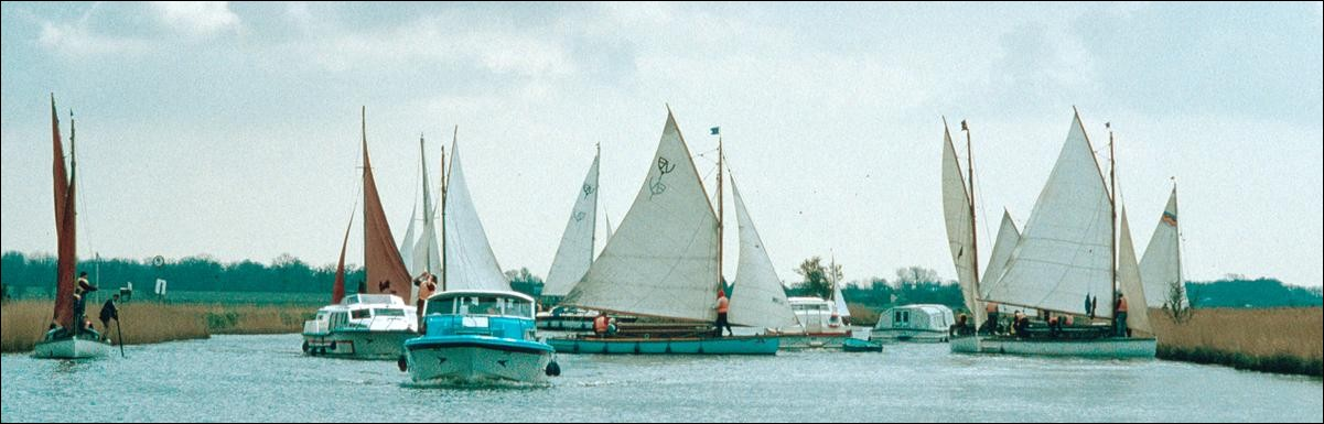River Bure crowded with sailing boats, Norfolk Broads, England