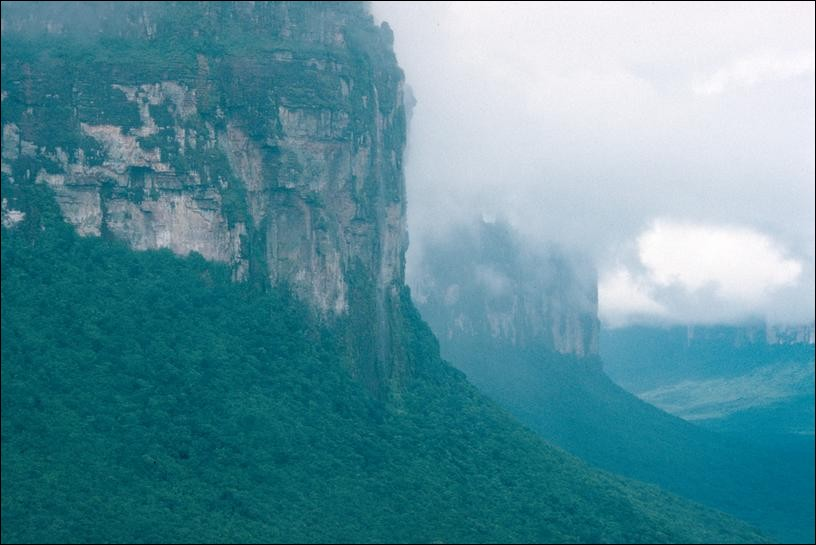 Tepuyes rising from the jungle to the clouds, Angel Falls, Venezuela